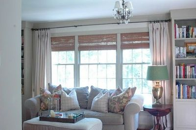 Sofa In Front Of Picture Window Bamboo Shades Solid Drapes For