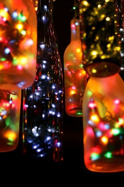 Outdoor Chandelier Made Of Beer And Wine Bottles And Christmas Lights! Have TONS of beer bottles for this DIYer!