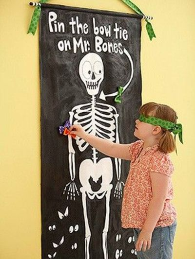 Pin the bow tie on the skeleton darling idea for for Halloween party games for preschoolers
