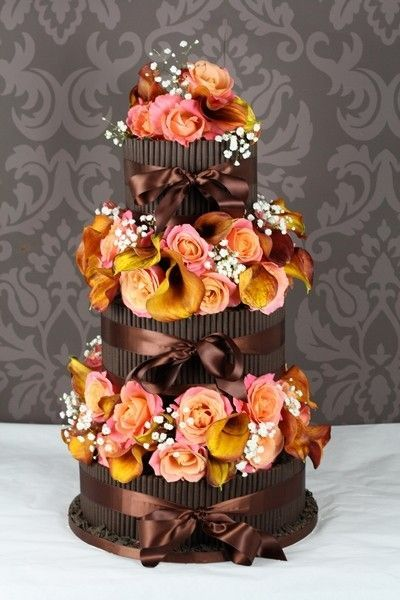 Cigarillo wedding cake. The flowers make it.