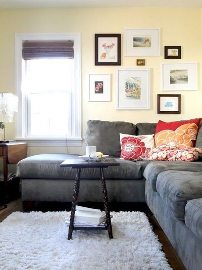 Gray Couch Dark Floors Light Rug Walls Red And