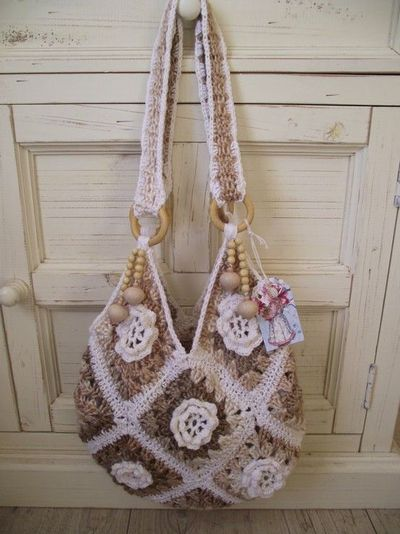 crocheted granny square bag embellished with crochet flowers and ...