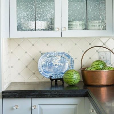 Light blue accents give this white kitchen backsplash a for Light blue kitchen backsplash