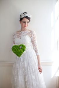 Get out! Lace dress with boat neck and 3/4th sleeves! Also, LOVE her unique bouquet!!!!!!!!!!