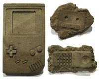 Cassettes, Nintendo controllers, Motorola cell phones, Floppy Disks, Sony Walkmans, Boomboxes, 8-Track Tapes and rotary phones are among the cement hand-cast 'modern fossils' by artist Christopher Locke of Austin, Texas. Using a special process, t...