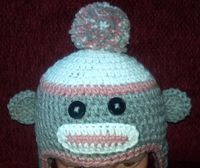 Sock monkey hat, earflaps and braids, crocheted, photo prop by ExpertCraftss on Etsy