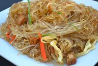 Pancit Bihon: This Pancit is a dish you can throw together in minutes and have everyone think it took hours (glute...[read more at Food Frenzy]