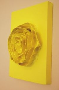 Painters tape (for the rose), a blank canvas, and the color of your choice!
