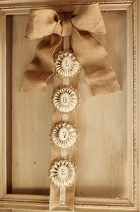 Great frame with burlap ribbon and bow.