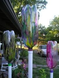 """Garden Harps"" or ""Plastorgan"" made out of plastic bottles. The wind blows through slits in them making different sounds.These would be really neat painted as ghosts for halloween! There is a link on the page to hear the sounds they make -..."