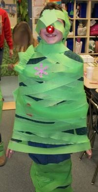 Christmas tree relay game: Each team was given a roll of green crepe paper and ornaments. They had to decorate one person from their team to look like a Christmas tree.