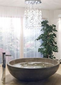 Circular tub and chandelier