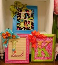 Brightly painted frames, cardboard letters and loud scrapbook paper...