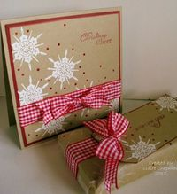 luv these bright white snowflakes and the perfect red gingham ribbon bow on kraft...