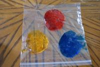 exploring colors using food coloring and hair gel in a plastic bag