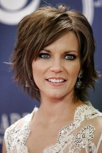 Super cute cut & color. Goes great with her blue eyes.