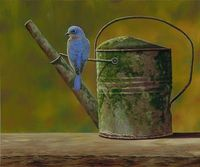 bluebird on old tin watering can