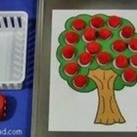A math center activity that children can play individually or in groups. Children roll the dice and remove the number of apples (red pom-poms) fro...
