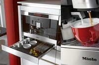 Miele Built in Coffee Maker Don't worry about filling a reservoir and cleaning out a pot every day. The Miele Built-in Coffee Maker is probably our favorite with a storage drawer that can hold your grounds and mugs so you don't ever have to go...