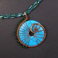La Mer Turquoise Wire Wrapped Pendant and Beadwoven Necklace Gorgeous big and bold wire wrapped pendant of Summer-y blue turquoise stone donut wrapped in copper wire with green glass miyuki drop bead spine. Spiral stiched rope necklace in blue and green w...