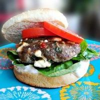 moist turkey burgers stuffed with feta, spinach and sun-dried tomatoes, topped with tzatziki