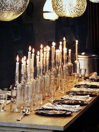 candles in clear wine bottles