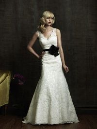 Scalloped v neck wedding dress. Maybe without the black sash though...