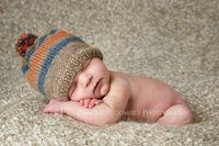Baby on blanket with cap