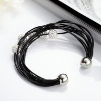 Multi Strand Leather Bracelet This Multi Strand Leather Bracelet features 5 Shamballa Crystal Beads scattering on multi leather strands. Crafted of genuine leather, the Shamballa Crystal Bead Multi Strand Leather Bracelet is secured with magnetic buckle.