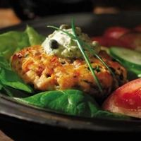 Salmon Burgers with Green Goddess Sauce The key to perfect salmon burgers is to handle the fish delicately: don't overseason, overhandle or overcook it.