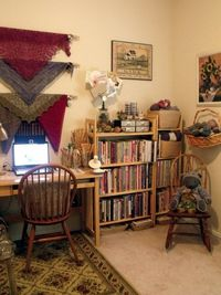 Love the way she has stored/displayed her lace shawls in her knitting space. A great idea for my home office.