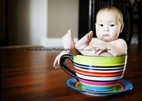 {infant photo trend} baby in giant teacup.