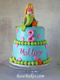 A Bright Mermaid Cake with a blond mermaid sitting on a rock.