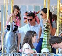 This pic of Katie Holmes reminds me of you. Not just her style and hair but the fact that she's riding on the merry go round, thats the kind of Mommy you are! And i love it! xo