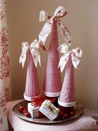 Wrap styrofoam cones with ribbon and add a bow