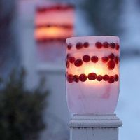 Illuminated Ice Parfait ~ Make a glowing outdoor parfait by alternating layers of cranberries and ice. Use a 2-liter bottle for the mold, and create a hollow place for the candle with a 1-liter bottle (fill the 1-liter bottle with rocks so it doesn...